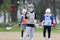 Harry Wilson practices a lacrosse technique, Friday, April 16, 2021 during a lacrosse clinic at Phillip's Park in Bentonville. Lacrosse is a rapidly growing sport in Northwest Arkansas. The Ozark Mountain Lacrosse program held a clinic for players in grades 7-12. Check out nwaonline.com/210417Daily/ for today's photo gallery. <br /> (NWA Democrat-Gazette/Charlie Kaijo)