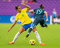 ORLANDO, FL - FEBRUARY 18: Rafaelle #4 of Brazil collides with Mariana Larroquette #19 of Argentina during a game between Argentina and Brazil at Exploria Stadium on February 18, 2021 in Orlando, Florida.