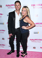 HOLLYWOOD, LOS ANGELES, CA, USA - SEPTEMBER 19: Casey Monroe and Adrienne Maloof arrive at Perez Hilton's 10th Anniversary Party held at the Hollywood Athletic Club on September 19, 2014 in Hollywood, Los Angeles, California, United States. (Photo by Xavier Collin/Celebrity Monitor)