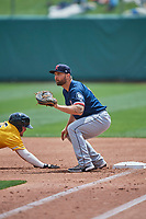 Sam Travis (12) of the Tacoma Rainiers on defense against the Salt Lake Bees at Smith's Ballpark on May 16, 2021 in Salt Lake City, Utah. The Bees defeated the Rainiers 8-7. (Stephen Smith/Four Seam Images)