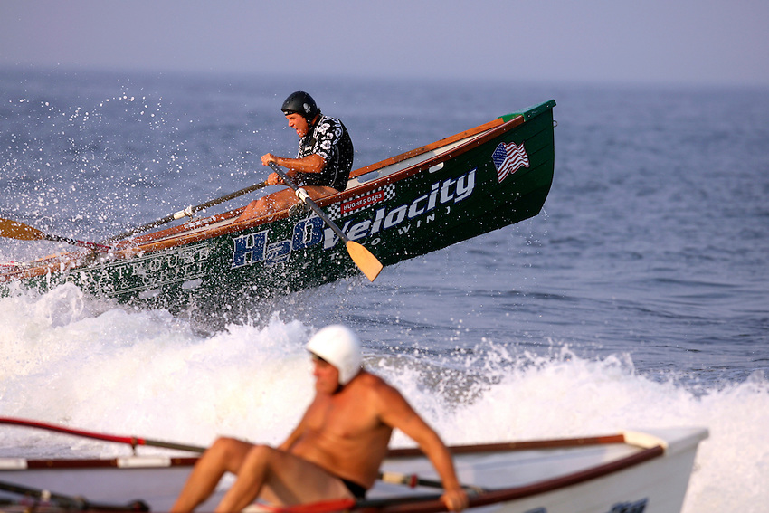 Long Branch's Billy George is rocketed airborne at the start of the 3,000-meter surfboat event at the First Annual Asbury Park Beach Bar Lifeguard Competition held at the 3rd Avenue beach in Asbury Park.  ASBURY PARK, NJ  8/4/07  8:21:47 PM  PHOTO BY ANDREW MILLS.
