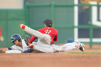Northwest Arkansas Naturals infielder Angelo Castellano (16) is tagged out by Springfield Cardinals infielder Jose Martinez (31) at second on May 16, 2019, at Arvest Ballpark in Springdale, Arkansas. (Jason Ivester/Four Seam Images)
