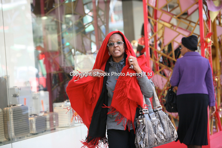 Grace Mugabe with red scarf and glasses in Hong Kong's, Kowloon 15th Jan 2009. Photo taken moments after an assault on photographer Richard Jones in Hong Kong 15th Jan 2014.<br /> <br /> photo by Sinopix