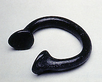 """World Civilization:  Benin--a manilla, Western Europe, 16th -19th century.  Brass; 2 1/2 """".  12 or 15 of these would purchase a slave."""