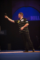 21.12.2014.  London, England.  William Hill World Darts Championship.  Ryan De Vreede [NED] in action during his match with Dave Chisnall (8) [ENG]. Chisnall won the match 3-0
