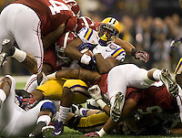 Alabama defenders tackles LSU quarterback Jordan Jefferson during BCS National Championship game at Mercedes-Benz Superdome in New Orleans, Louisiana on January 9th, 2012.   Alabama defeated LSU, 21-0.