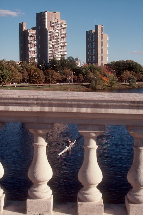 Harvard University, Peabody Terrace, designed by architect Le Corbusier, from the Weeks Bridge, Charles River,  Cambridge, Massachusetts, New England, USA, single sculler rowing,.
