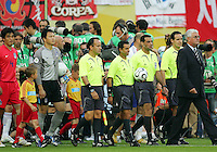 Referees from CONCACAF area plus fourth official Abd El Fatah of Egypt enter the field. The Korea Republic and France played to a 1-1 tie in their FIFA World Cup Group G match at the Zentralstadion, Leipzig, Germany, June 18, 2006.