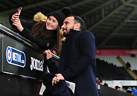 A young fan of Swansea City takes a selfie with club legend Leon Britton during the Sky Bet Championship match between Swansea City and Norwich City at the Liberty Stadium, Swansea, Wales, UK. Saturday 24 November 2018