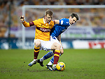 Motherwell v St Johnstone…20.02.21   Fir Park   SPFL<br />Craig Bryson tackles Nathan McGinlay<br />Picture by Graeme Hart.<br />Copyright Perthshire Picture Agency<br />Tel: 01738 623350  Mobile: 07990 594431