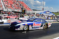 Jun. 15, 2012; Bristol, TN, USA: NHRA pro stock driver Jason Line (near lane) races alongside his teammate Greg Anderson during qualifying for the Thunder Valley Nationals at Bristol Dragway. Mandatory Credit: Mark J. Rebilas-