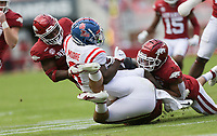 Arkansas defensive back Jalen Catalon (1) tackles Ole Miss wide receiver Elijah Moore (8), Saturday, October 17, 2020 during the second quarter of a football game at Donald W. Reynolds Razorback Stadium in Fayetteville. Check out nwaonline.com/201018Daily/ for today's photo gallery. <br /> (NWA Democrat-Gazette/Charlie Kaijo)