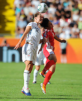 Lauren Cheney (l) of Team USA and Kim Su Gyong of Team North Korea during the FIFA Women's World Cup at the FIFA Stadium in Dresden, Germany on June 28th, 2011.