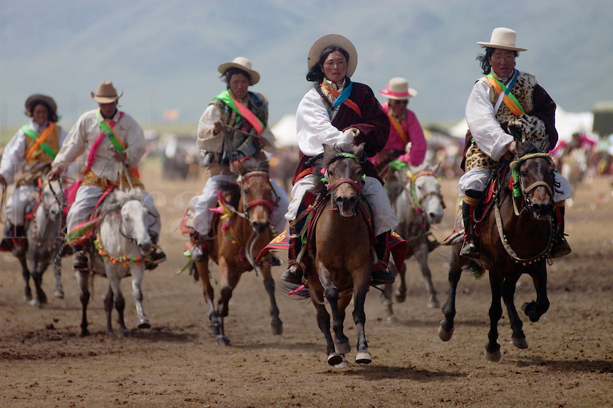 Khampas entertain the crowd in a rowdy horse race at the Litang Horse Festival - Kham, Sichuan Province, China, (Tibet)