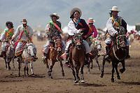 Khampas entertain the crowd in a rowdy horse race at the Litang Horse Festival - Kham, Sichuan Province, China, (Tibet)