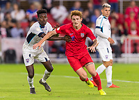 WASHINGTON, DC - OCTOBER 11: Erick Rizo #3 of Cuba tries to slow down Josh Sargent #19 of the United States during a game between Cuba and USMNT at Audi Field on October 11, 2019 in Washington, DC.