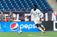 FOXBOROUGH, MA - SEPTEMBER 5: Raheem Somersall #13 of Tormenta FC dribbles at midfield during a game between Tormenta FC and New England Revolution II at Gillette Stadium on September 5, 2021 in Foxborough, Massachusetts.