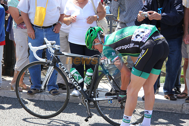 Thomas Voeckler (FRA) Team Europcar checks his bike at sign on before Stage 10 of the 99th edition of the Tour de France 2012, running 194.5km from Macon to Bellegarde-sur-Valserine, France. 11th July 2012.<br /> (Photo by Thomas van Bracht/NEWSFILE)