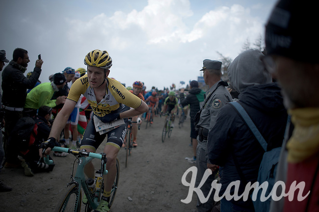 Rick Flens (NLD/LottoNL-Jumbo) stuffing a gazette under his jersey (against the cold down the descent) up the dirt roads of the Colle delle Finestre (2178m)<br /> <br /> Giro d'Italia 2015<br /> stage 20: Saint Vincent - Sestriere (199km)
