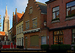 Restaurants on the Walplein and Onze-Lieve-Vrouwkerk Church of Our Lady at Sunrise, Bruges, Brugge, Belgium