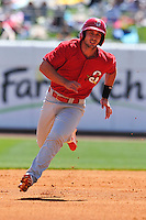 Springfield Cardinals Paul DeJong (12) runs to third base during the game against the Northwest Arkansas Naturals at Arvest Ballpark on May 4, 2016 in Springdale, Arkansas.  Springfield won 10-6.  (Dennis Hubbard/Four Seam Images)