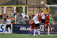 Canada (CAN) goalkeeper Karina LeBlanc (1) punches a ball clear in traffic. The United States (USA) Women's National Team defeated Canada (CAN) 1-0 during an international friendly at Marina Auto Stadium in Rochester, NY, on July 19, 2009.