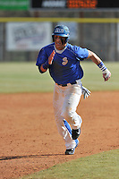 Third baseman Chris Burgess (19) of the Spartanburg Methodist College Pioneers run toward third base a junior college game against Surry Community College on January 31, 2016, at Mooneyham Field in Spartanburg, South Carolina. (Tom Priddy/Four Seam Images)