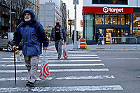 NEW YORK, NEW YORK - MARCH 02: People crosses a street after leaving a Target store on March 02, 2021 in New York. Target hopes to build a growth by investing about $ 4 billion annually for the next years to accelerate the consolidation of new stores, upgrade existing ones and enhance its capacity to fulfill online orders. (Photo by Emaz/VIEWpress)
