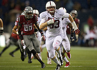SEATTLE, WA - September 28, 2013: Stanford linebacker Trent Murphy return an interception for a touchdown against Washington State at CenturyLink Field. Stanford won 55-17