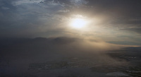 aerial photograph of a dust storm as it envelopes Furnace Creek, Death Valley National Park, northern Mojave Desert, California