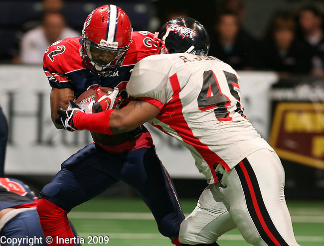 SIOUX FALLS, SD - APRIL 18:  Marques Smith #22 of the Sioux Falls Storm tries to escape the grasp of Rudy Jones #45 of the Sioux City Bandits in the second quarter of their game Saturday night at the Sioux Falls Arena.(Photo by Dave Eggen/Inertia)