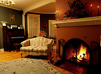 File Photo<br /> <br /> Fireplace in a bed and breakfast living room<br /> <br /> <br /> Mandatory Credit: Photo by Pierre Roussel- Images Distribution. (©) Copyright 2004 by Pierre Roussel <br /> <br /> NOTE : scan from 2 1/4 slide