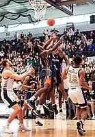 WASHINGTON, DC - NOVEMBER 16: Malik Miller #11 and Sherwyn Devonish #5 of Morgan State go up against Justin Williams #4 of George Washington during a game between Morgan State University and George Washington University at The Smith Center on November 16, 2019 in Washington, DC.