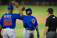 AZL Cubs third baseman Delvin Zinn (21) receives a high five from assistant hitting coach Leonel Perez (66) after an RBI single in the fifth inning against the AZL Giants on September 7, 2017 at Scottsdale Stadium in Scottsdale, Arizona. AZL Cubs defeated the AZL Giants 13-3 to win the Arizona League Championship Series two games to one. (Zachary Lucy/Four Seam Images)