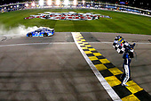 Monster Energy NASCAR Cup Series<br /> Go Bowling 400<br /> Kansas Speedway, Kansas City, KS USA<br /> Saturday 13 May 2017<br /> Martin Truex Jr, Furniture Row Racing, Auto-Owners Insurance Toyota Camry celebrates his win <br /> World Copyright: Russell LaBounty<br /> LAT Images<br /> ref: Digital Image 17KAN1rl_5893