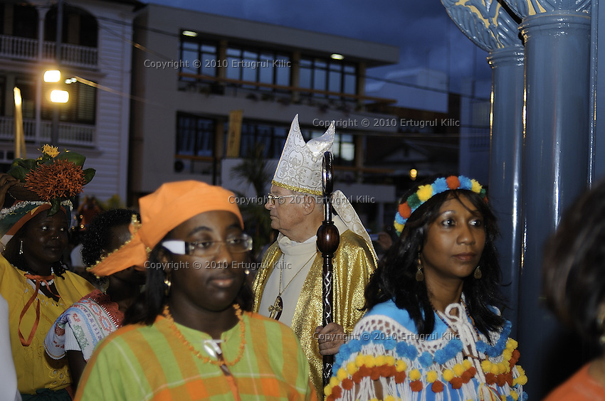 Representatives of the faithful - young, elderly, men, women, children of Amerindian, African, Indian, Chinese and Indonesian descent - enters to  ST. Petrus and Paulus Cathedral after the doors were opened.....Blessing and First Worship of ST. Petrus and Paulus Cathedral (AKA World's largest wooden cathedral)