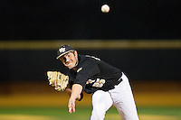 Matt Conway (25) of the Wake Forest Demon Deacons delivers a pitch to the plate against the West Virginia Mountaineers at Wake Forest Baseball Park on February 24, 2013 in Winston-Salem, North Carolina.  The Demon Deacons defeated the Mountaineers 11-3.  (Brian Westerholt/Four Seam Images)