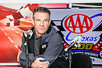 Actor Dennis Quaid, conducts an interview before the NASCAR AAA Texas 500 race at Texas Motor Speedway in Fort Worth,Texas.