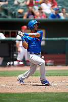 Iowa Cubs first baseman Jeimer Candelario (5) follows through on a swing during a game against the Memphis Redbirds on May 29, 2017 at AutoZone Park in Memphis, Tennessee.  Memphis defeated Iowa 6-5.  (Mike Janes/Four Seam Images)