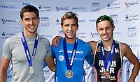 25 MAR 2012 - LOUGHBOROUGH, GBR - Mark Buckingham (Holmfirth Harriers) (centre) celebrates winning the 2012 British Elite Men's Duathlon Championship title at Prestwold Hall Airfield in Prestwold near Loughborough, Great Britain with silver medalist Matthew Gunby (PACTRAC) (left) and bronze medalist Lawrence Fanous (Jordan Triathlon) (right) (PHOTO (C) 2012 NIGEL FARROW)