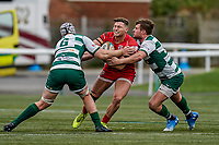 George Spencer of Jersey Reds is tackled during the Championship Cup QF match between Ealing Trailfinders and Jersey Reds at Castle Bar, West Ealing, England  on 22 February 2020. Photo by David Horn.