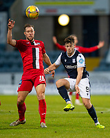 19th December 2020; Dens Park, Dundee, Scotland; Scottish Championship Football, Dundee FC versus Dunfermline; Steven Whittaker of Dunfermline Athletic challenges for the ball with Danny Mullen of Dundee