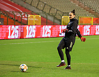 Belgian goalkeeper Nicky Evrard (21) gives a pass during the warm up before a friendly female soccer game between the national teams of Belgium , called the Red Flames and The Netherlands , called the Oranje Leeuwinnen in a pre - bid tournament called Three Nations One Goal with the national teams from Belgium , The Netherlands and Germany towards a bid for the hosting of the 2027 FIFA Women's World Cup , on Thursday 18 th of February 2021  in Brussels , Belgium . PHOTO SPORTPIX.BE | SPP | SEVIL OKTEM