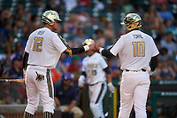 Seth Beer (12) of Lambert High School in Suwanee, Georgia fist bumps Alex Toral (10) of Archbishop McCarthy High School in Davie, Florida during the Under Armour All-American Game on August 15, 2015 at Wrigley Field in Chicago, Illinois. (Mike Janes/Four Seam Images)