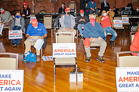 """Audience members sit in chairs with signs reading """"Make America Great Again"""" before Eric Trump, son of US president Donald Trump, holds a Make America Great Again! campaign rally at the DoubleTree by Hilton Manchester Downtown in Manchester, New Hampshire, on Mon., Oct. 19, 2020. The chairs are distanced to follow safety protocols during the ongoing Coronavirus (COVID-19) global pandemic, just a few weeks after Donald Trump himself contracted the disease, though many other Trump campaign events are lax about COVID safety protocols."""
