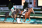 #2 Island Town and jockey Julien Leparoux win the Matt Winn, over #5 Fame and Power and jockey Victor Espinoza, at Churchill Downs for owners Six Column Stables, Randall Bloch, John Seiler and David Hall and trainer Ian Wilkes.