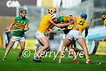 Jason Diggins, Kerry in action against Joe Maskey, Antrim and Niall McKenna, Antrim during the Joe McDonagh Cup Final match between Kerry and Antrim at Croke Park in Dublin.