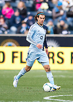 Graham Zusi (8) of Sporting Kansas City carries the ball upfield during the game at PPL Park in Chester, PA.  Kansas City defeated Philadelphia, 3-1.