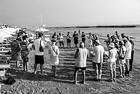 Romagna, riviera  adriatica, preghiera in spiaggia, religione cattolica