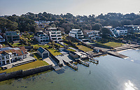 BNPS.co.uk (01202) 558833. <br /> Pic: AshleyFaull/BNPS<br /> <br /> Pictured: CGI plans for the new apartment block being built on the edge of Poole Harbour. <br /> <br /> A wealthy homeowner has made the 'brave' decision to demolish his £6m seaside mansion that has its own indoor pool, gym and cinema. <br /> <br /> Ashley Faull has flattened the 20-year-old luxury house to build nine new flats to meet the increasing demand for housing that has led to a surge in property prices.<br /> <br /> The apartments will be priced between £1.495m to £2.8m.<br /> <br /> The now ruined four-storey and 19-room home sits on a half-an-acre plot that backs on to Poole Harbour and overlooks exclusive Sandbanks in Dorset.